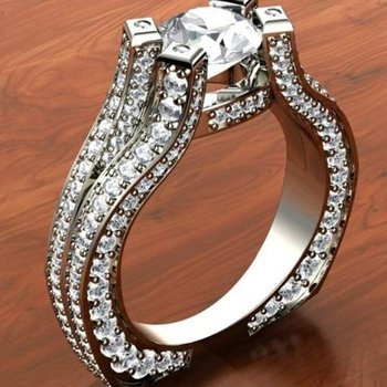 Double shank engagement ring with round diamond centered