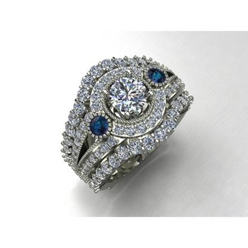 Diamond engagement ring with sapphires on a side
