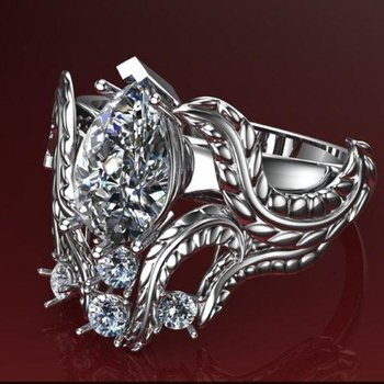 Filligree style engagement ring with pear shaped diamond centered