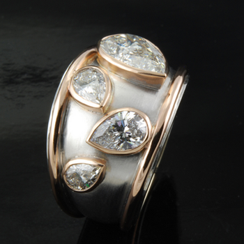 Fashion ring with pear shape diamonds