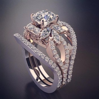 Unique rose gold engagement ring with round and marquise diamonds