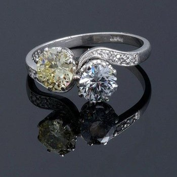 Elegant light yellow diamond and white diamond engagement ring