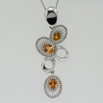 Pendant with orange sapphires
