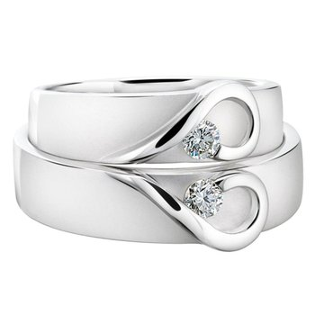 Delicate wedding band with diamonds