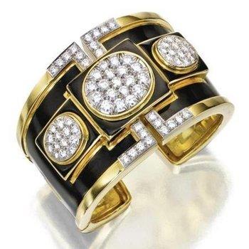 Modern gold bracelet with black enamel and diamonds