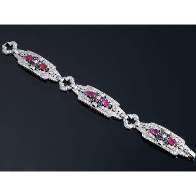 Antony Jewelers Antique style Diamond Bracelet with emeralds and rubies centered