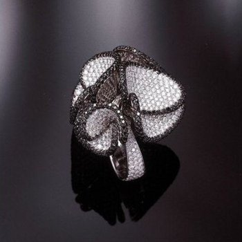 Fashion ring with black and white diamonds
