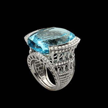 Fashion ring with round diamonds and blue topaz