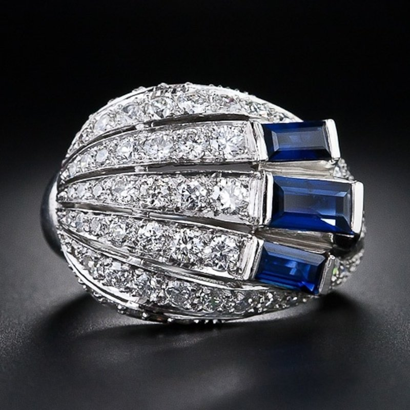 Beautifully designed fashion ring with diamonds and sapphires.