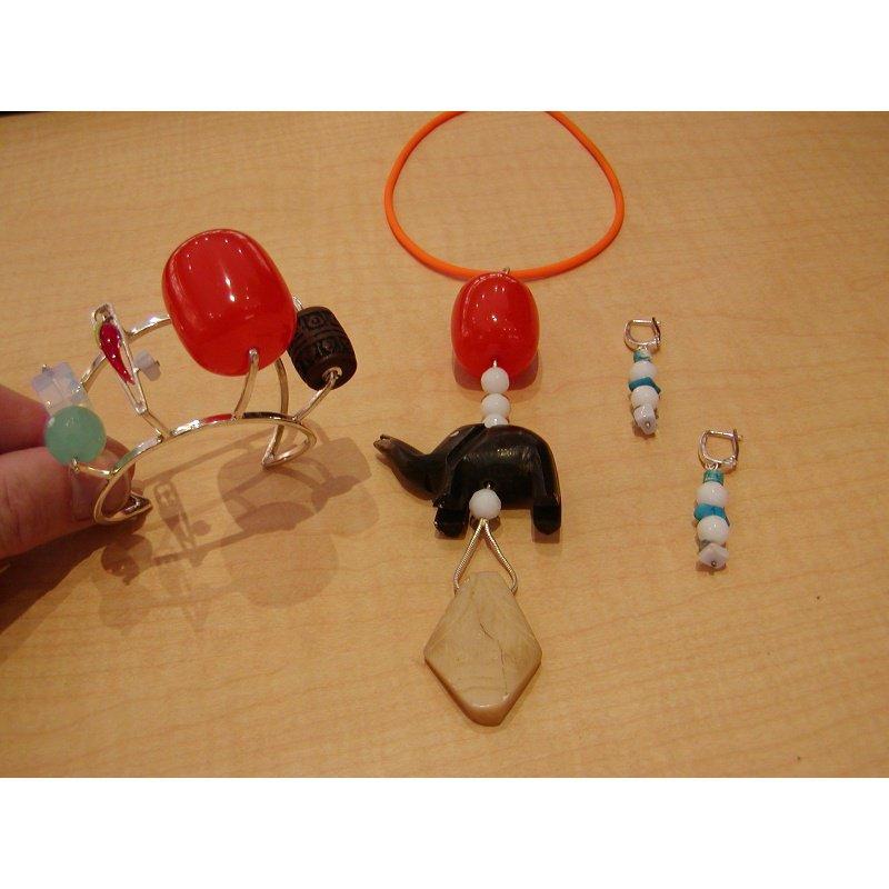 Antony Jewelers Contemporary style set: bangle, necklace, earrings.