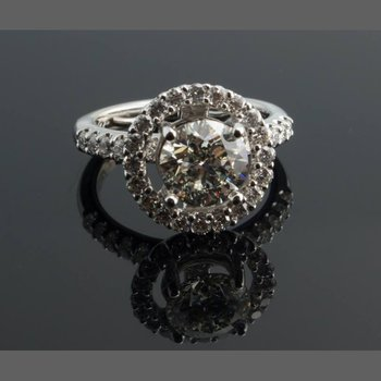 Diamond halo engagement ring with round diamond centered
