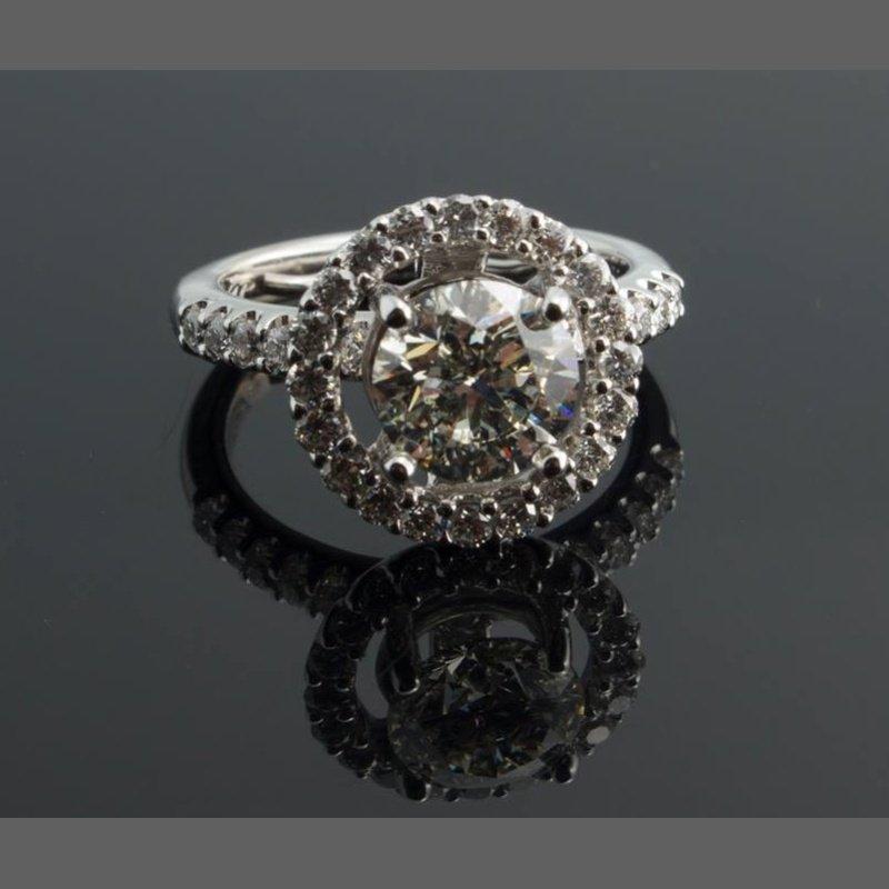 Antony Jewelers Diamond halo engagement ring with round diamond centered