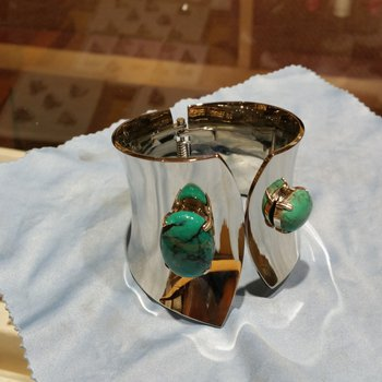 Silver bangle-cuff bracelet with turquoise stones