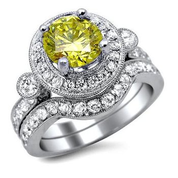 Curved engagement ring with yellow diamond