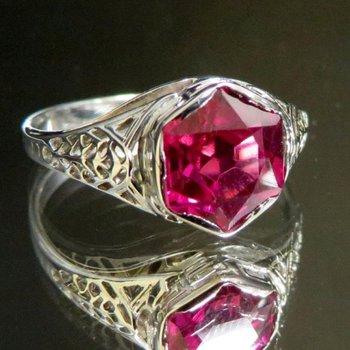 Vintage engagement ring with a ruby