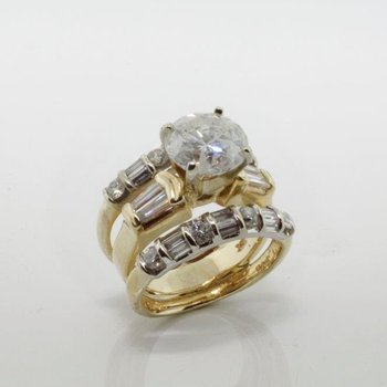 Diamond mixed yellow gold engagement ring with matching bands