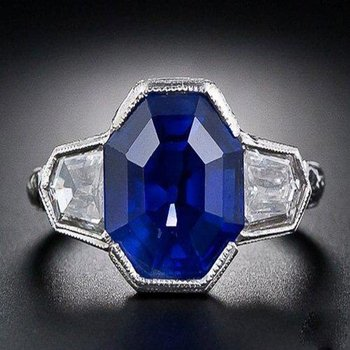 Platinum sapphire ring with diamonds on a side