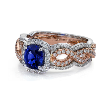 Two tone engagement ring with diamonds and sapphire