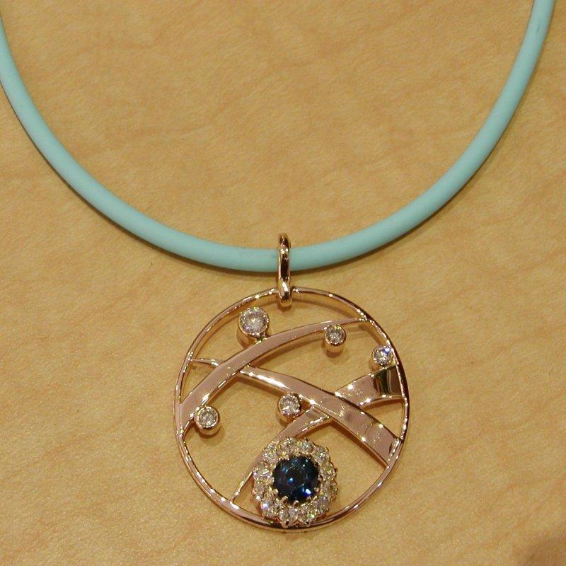 Antony Jewelers Pendant with round sapphire and diamonds
