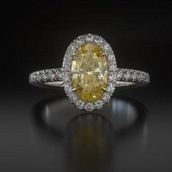 Diamond engagement ring with rare yellow diamond