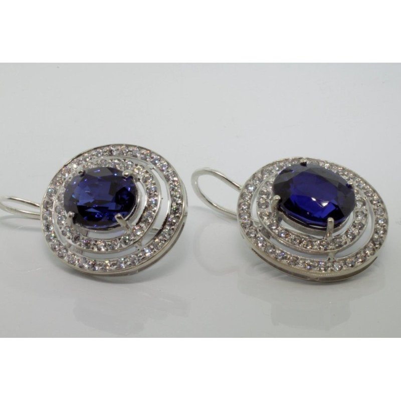 Antony Jewelers Double Halo earrings with diamonds and sapphires