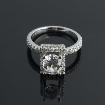 Diamond engagement ring with square halo design