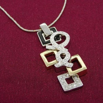 Geometrical white and yellow gold diamond pendant