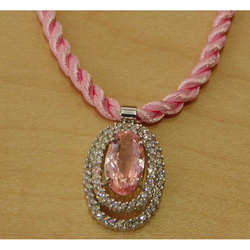 Antony Jewelers Double halo pendant with diamonds and pink sapphire