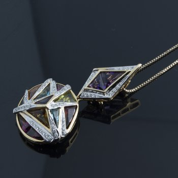 Assymetrical pendant with multi color sapphires