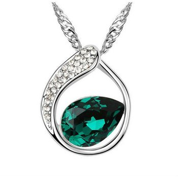 Elegant pendant with green topaz and diamonds