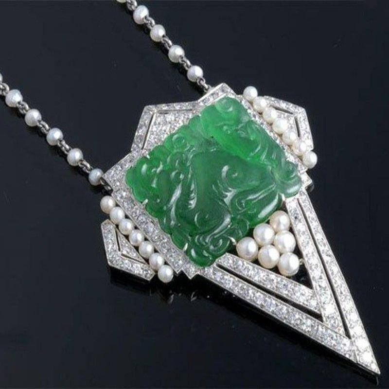 Antony Jewelers  Assymetrical necklace with tear shaped  carved jade , pearl and diamonds