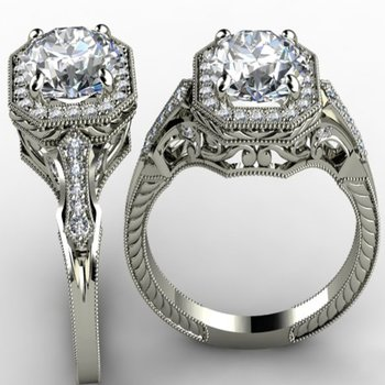 Filigree style engagement ring with cushion diamond centered