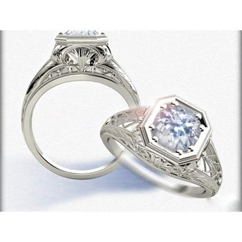 Engagement ring with filligree style and 1 round diamond centered