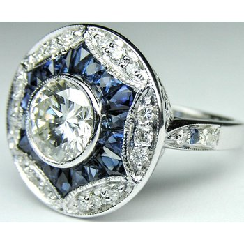 Antique engagement ring with diamonds and sapphires
