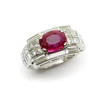 Geometrically designed engagement ring with diamond and ruby
