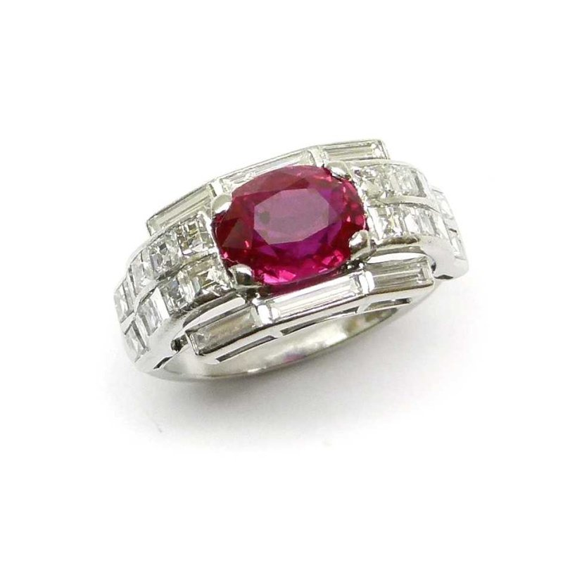 Antony Jewelers Geometrically designed engagement ring with diamond and ruby