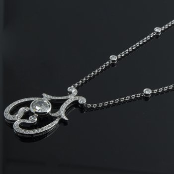 Antique style swirl diamond necklace
