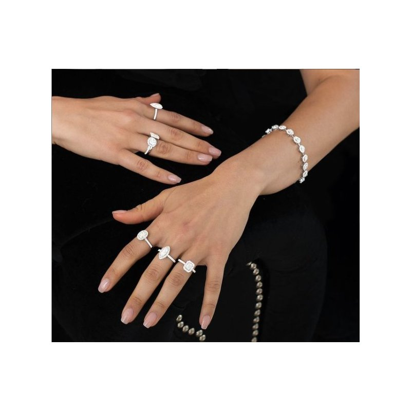 Calvin Broyles Proposal Ready 1/2 Carat Marquise Shape Center Diamond Halo Engagement Ring