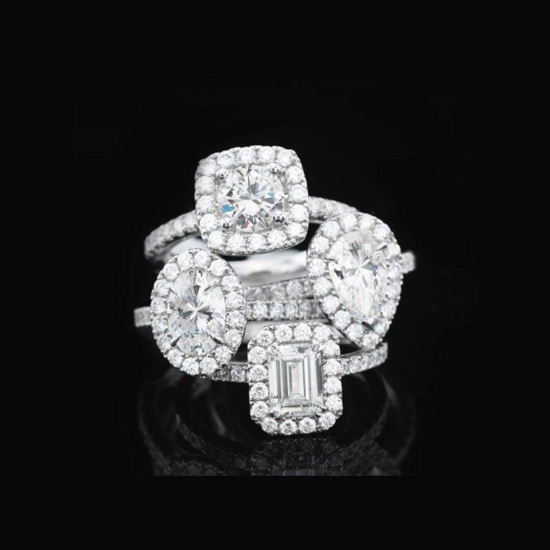 Calvin Broyles Proposal Ready 3/4 Carat Oval Shape Center Diamond Halo Engagement Ring