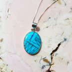 Arizona Turquoise and Inlaid Jewelry Oval Sonoran Pendant