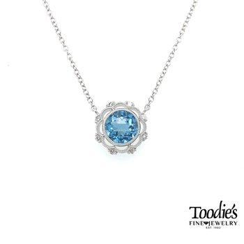Blue Topaz and Diamond Floral Halo Pendant
