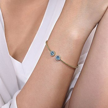 Blue Topaz And Diamond Halo Bangle