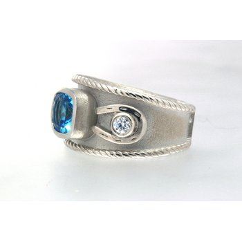 SS and topaz horseshoe, wide band ring