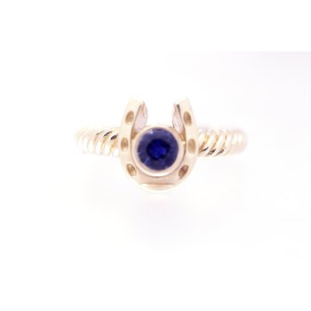 Yellow gold horseshoe ring with a  Sapphire