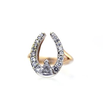 yellow gold and diamond horseshoe ring. With a Trillion diamond center.