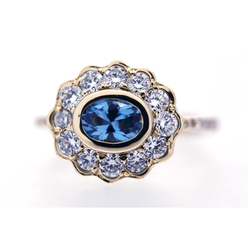 Blue Topaz, Diamonds, and Yellow Gold Ring
