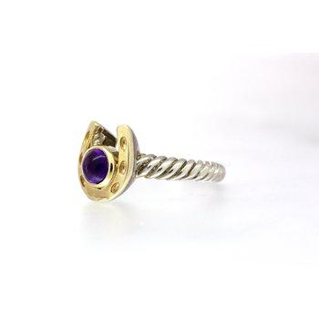 Two tone horseshoe ring with a bezel set Amethyst Cabochon