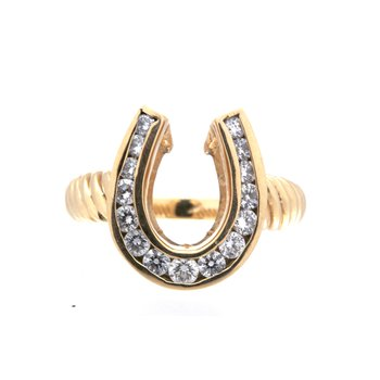 Yellow gold and diamond horseshoe with a twisted band