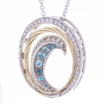 14kt gold wave pendant with blue topaz and diamonds