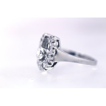 White gold and diamond horseshoe ring with a diamond , bezel set center